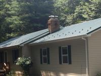 24' x 30' x 9' garage addition on house with new metal roofing to match on house