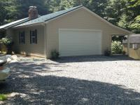 24' x 30' x 9' pole building garage addition to existing house